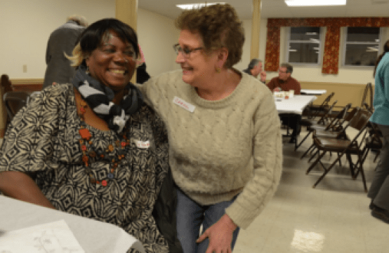 Mary George, left, and Carol, a Manchester resident, enjoyed the fellowship of the Communication Cafe.