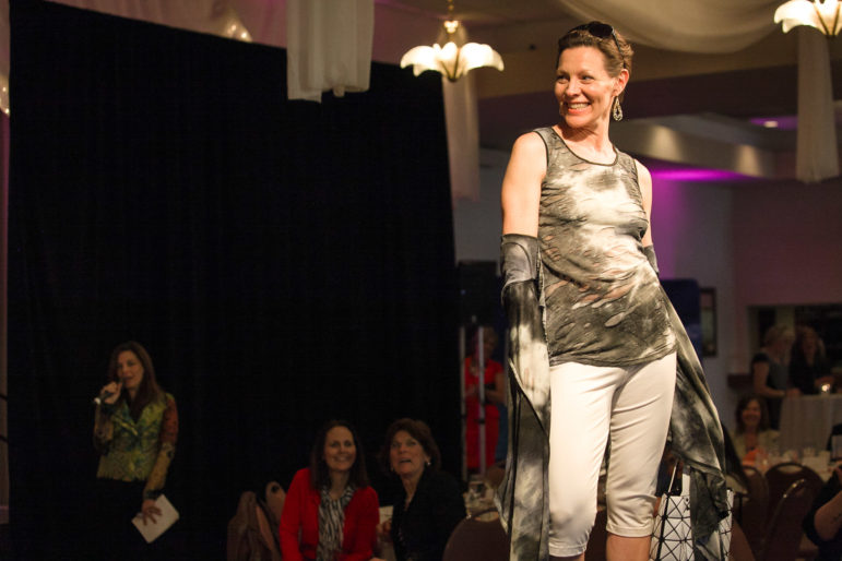 NHPR's Virginia Prescott poses at the end of the runway during CASA of New Hampshire's 10th annual Spring Fashion Show and Auction on April 11, 2014. CASA's largest annual fundraiser, this year's Fashion Show and Auction will be Friday, April 10. Tickets are available online at www.casanh.org.