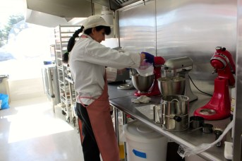 Pastry chef Zena Cron mixing some batter.