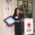 Red Cross Services volunteer Bao Dang accepts the 2013 International Humanitarian Award in Washington, D.C.