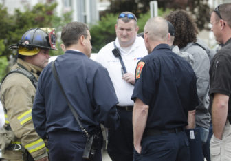 Police, Fire and DEA officials at a Lake Avenue address for a drug investigation May 18.