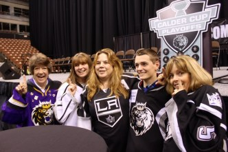 From left, Jody Messenheimer of Hudson, Erin Collins and Maureen Collins of Allenstown, Tyler Jodoin and Debbie Jodoin of Concord, pose in front of the game-winning puck display.