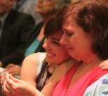 Paige Willard, left, and her mom Diane reflect the range of emotions of the day.
