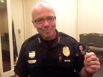 Chief Nick Willard with a photograph of his daughter, Rachel, who was unable to travel from Chicago for the swearing in ceremony.