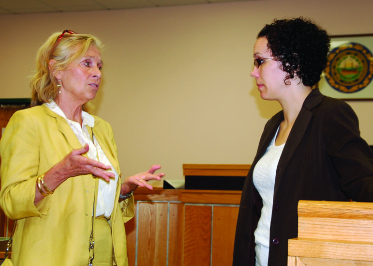 Diane Levesque, left, director of the Veterans Justice Outreach program at the VA in Manchester, speaks with Allenstown police prosecutor Alicia Piazza before a court hearing in Hooksett.