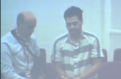 Screenshot from video extradition hearing  for Matthew Dion, June 4.