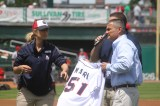 Mara receives an honorary Fisher Cats jersey.