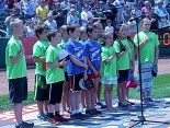 Students from Riddle Brook Elementary School in Bedford sing the National Anthem.
