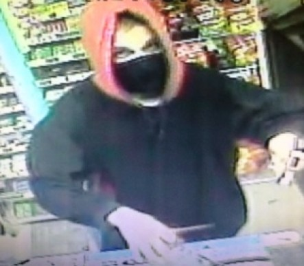 AA Market robbery suspect mugs for the security camera.