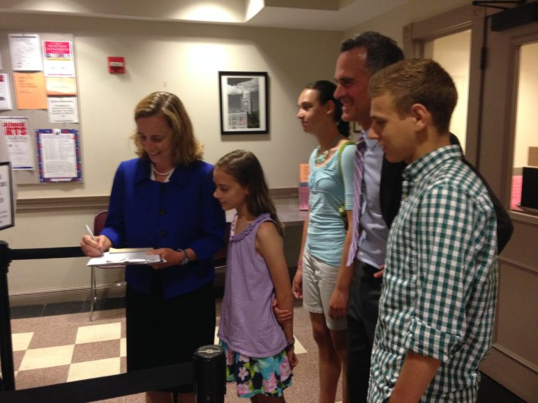 Joyce Craig files paperwork to run for mayor on July 13. She was joined by her husband, Michael, and their three children, William, Sarah, and Kathryn.