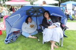 Katlyn L'Italien, left, and Megan Morin, under their big umbrella.