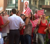 Teachers rally outside City Hall before Monday night's meeting.