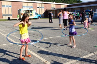 Twin sisters Isabelle and Hannah hooping it up during National Night Out.