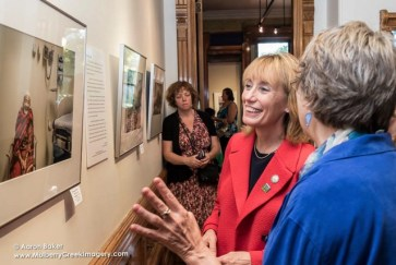Photographer Becky Field walks Gov. Maggie Hassan through an exhibition of her work during the Sept. 17 book launch.
