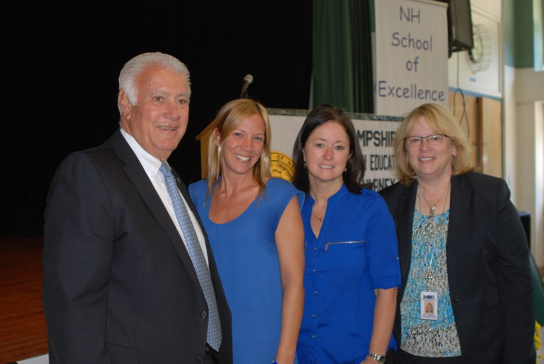 Superintendent Debra Livingston, far right, principal Amy Allen, and Mayor Ted Gatsas were at the school assembly to congratulate Ashley Preston, second from left.
