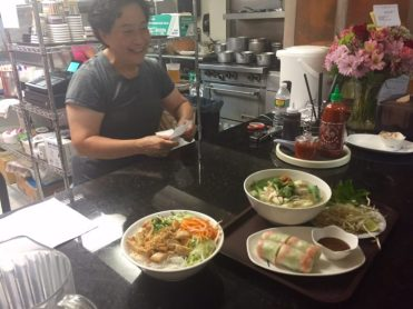 Owner Chan Loi delivers the goods to hungry diners.