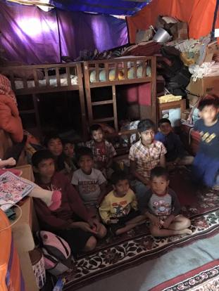 Inside the temporary shelter, 23 children and their two founders have lived since the earthquake.