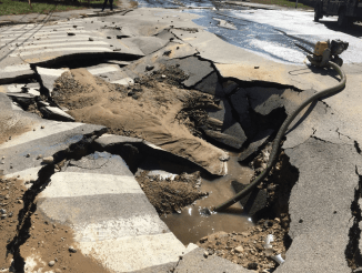 Close-up of road collapse