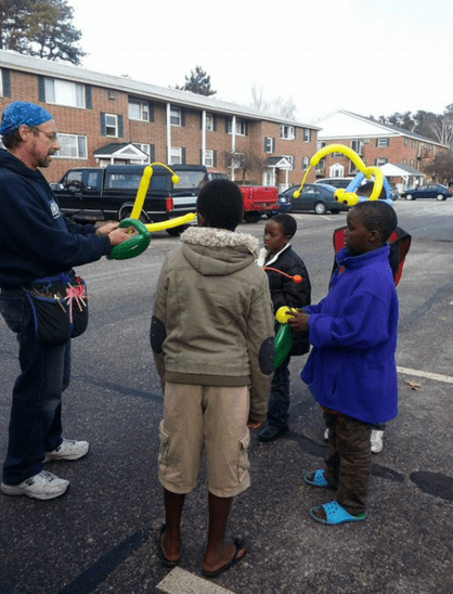Balloon guy with skills on location during 2014 Shire Sharing distribution day.