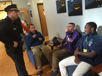 Job Corps recruits who will be training for jobs in the security field talk with Manchester Police Lt. Brian O'Keefe.