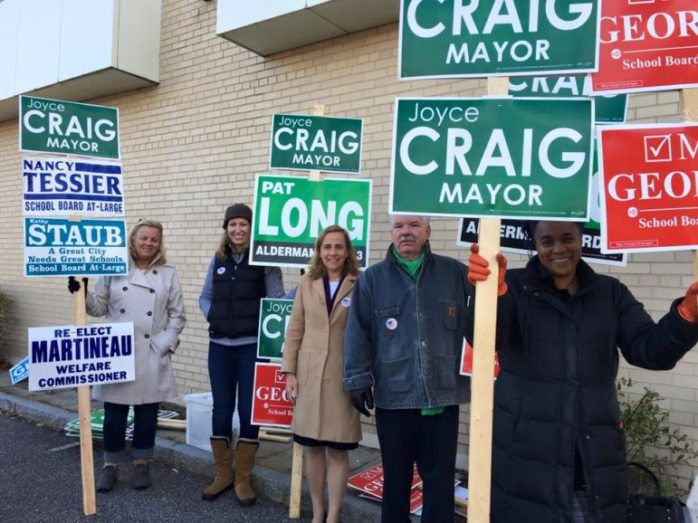 Joyce Craig, center, campaigning on Election Day at the polls.