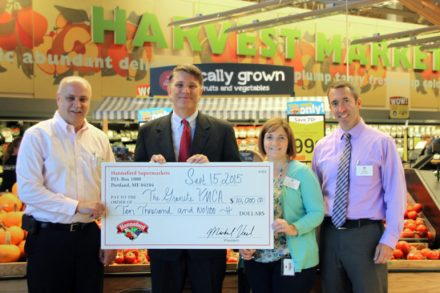 From left, Carl Provencher-Store Manager, Goffstown Hannaford; Chris Dugan- VP of Marketing, Granite YMCA; Lisa Lessard-Store Manager, John Devine Drive Hannaford in Manchester; and John Fifield- Director of Operations for Hannaford Supermarkets in Central New Hampshire.