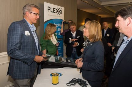 Michael Welts, VP of Marketing for Plexxi, describes his product, The Plexxi Switch 2, to New Hampshire Governor Maggie Hassan as part of the Product of the Year Award product demonstration portion of the event.