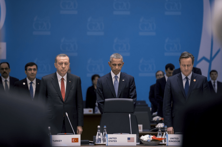 President Barack Obama, President Recep Tayyip Erdoğan of Turkey and Prime Minister David Cameron of the United Kingdom and the other members and staff of the G20 Summit, observe a moment of silence during Working Session One in Antalya, Turkey for the victims of the terrorist attacks in France, Sunday, Nov. 15, 2015. (