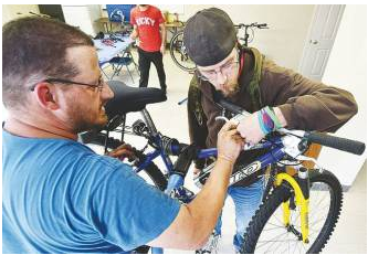 Queen City Bike Collective repairs and recycles bicycles, and holds weekly workshops to assist bike owners in repair and maintenance.