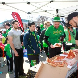 Justin Bachert, right, of Portland Pie Co. trying to keep up with the post-race crowd.