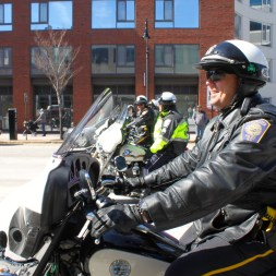 Manchester Police Officer Warren Olson, flanked by his fellow motorcycle cops.