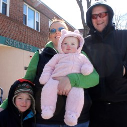 Bundled up: Roger and Talia Flannagan with son Landon and baby Parker, enjoy the parade.