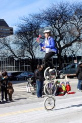 Gym Dandies on amazing stacked unicycles - while juggling!