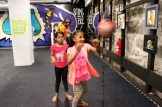 Prabina Ghataney, 10, and Aphasana Biswa, 9, take turns with one of the punching bags.