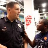 Officer John Lavasseur with Jacques Niyibaruta, 10.