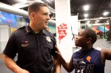 Officer John Lavasseur with Jacques Niyibaruta, 10.
