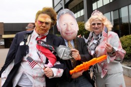 Moe Egan, of Manchester, left, as Zombie Trump, with Dan Dube of Bedford as Gary Johnson Zombie Hunter, center, and Ally Dube, also of Bedford, as Zombie Hillary