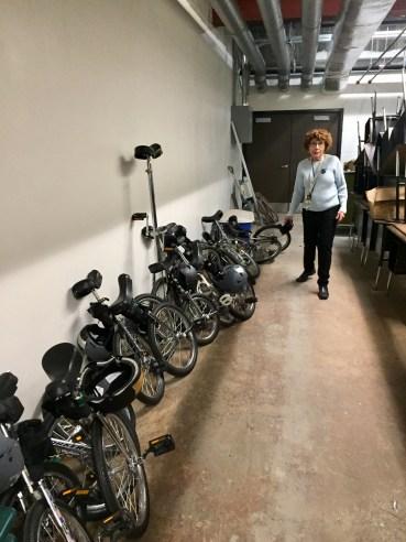 Benita Lebow takes stock of the Beech Street School unicycle fleet.