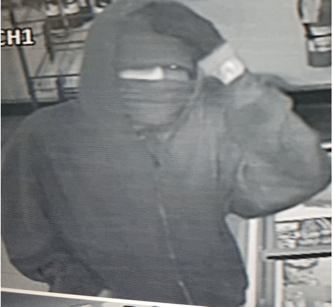 Robber caught on film. Do you know this man?