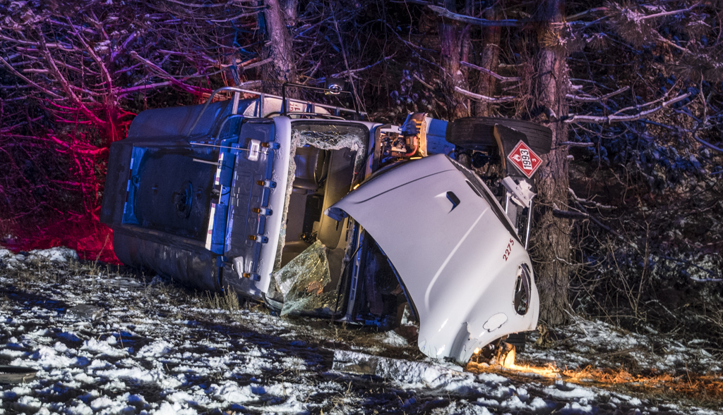 Diesel truck loses control on I-93, careens off highway, crashes into trees