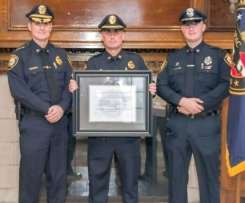 Chief Edward Conley, Lieutenant Fitzgerald and Officer Ryan Machain stand with certification
