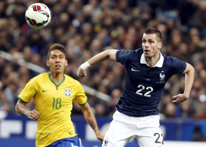 frances-morgan-schneiderlin-fights-for-the-ball-with-brazils-firmino-during-their-international-friendly-soccer-match-at-the-stade-de-france-in-saint-denis-near-paris