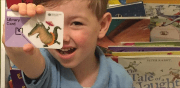 Child with his library card.