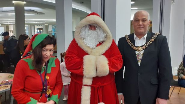 Photo of Mayor with Santa and elf