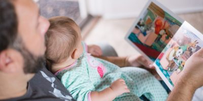 Baby being read to.