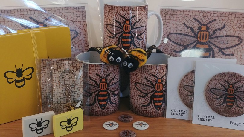 Selection of items featuring the Manchester Bee from Notebooks, Erasers, keyrings, mugs, magnets, prints and badges.