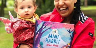 Adult and child with mini rabbit book