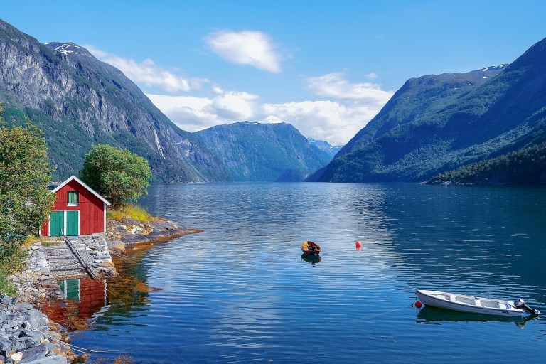 Escorted Motorhome Tour Stunning Norway Fjord with red house and boat