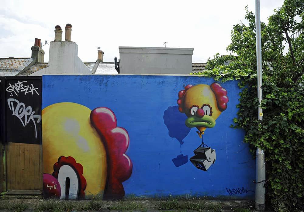 Clown street art in Trafalgar Lane, Brigton, England