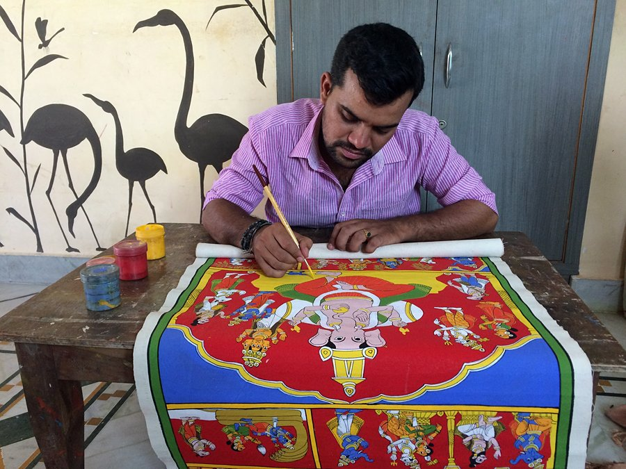 A member of the Vaikuntam', in Hyderabad paints a Cheriyal scroll, one of the many traditional arts and crafts in India